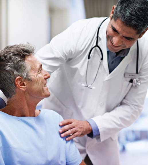 Male doctor talking with an older male patient