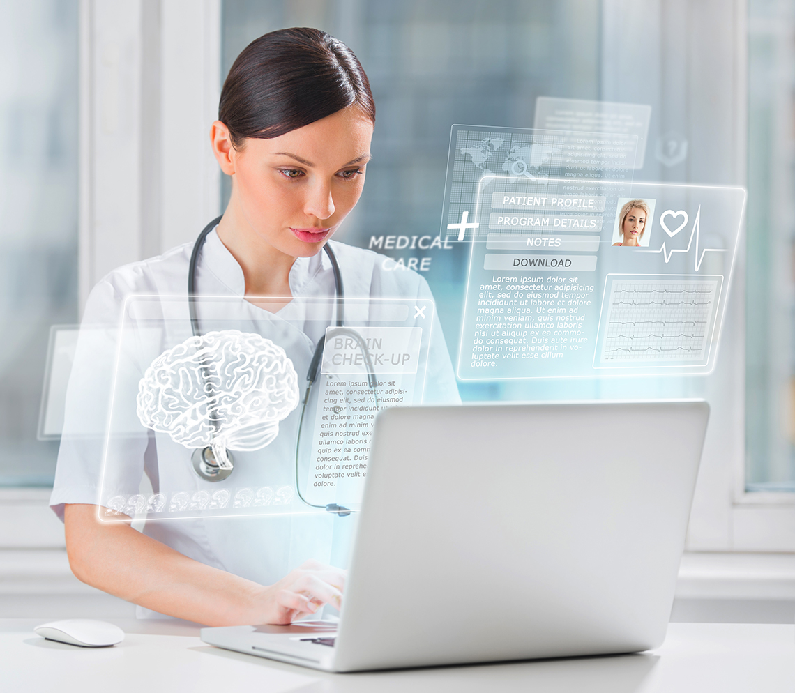 Health care provider reviews information on a computer.