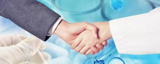 businessman and medical professional shaking hands