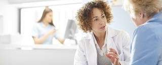female physician consults with a senior female patient