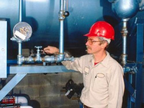 A person performing Boiler Operation and Care