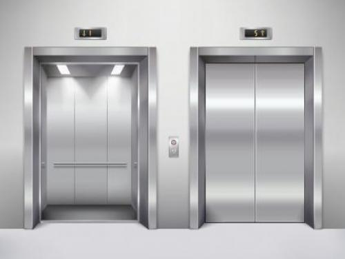 Two elevators side by side, with the doors closed