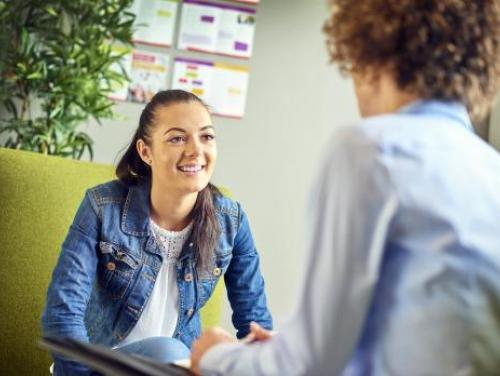 A youth employee smiles at an employer during an interview