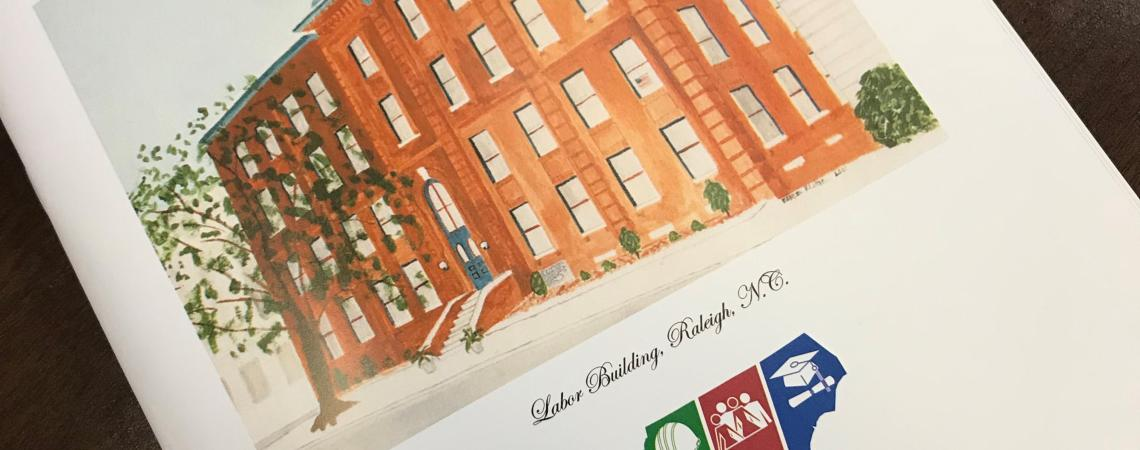 Annual Report booklet cover page with painting of red brick labor building on the front