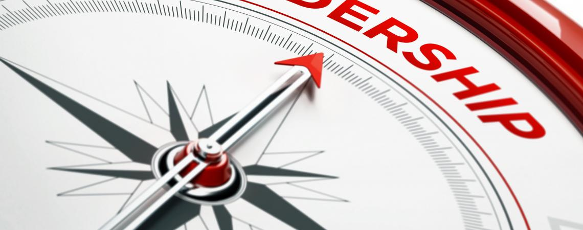 A red and black compass that points toward leadership