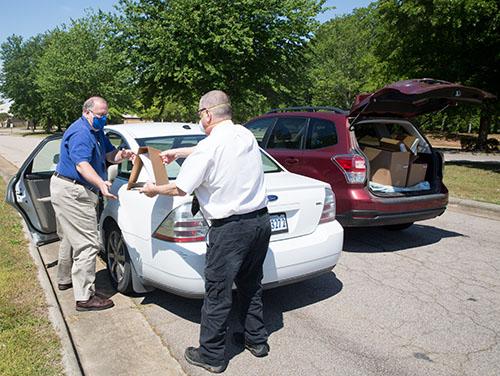 Men Loading Box in Car
