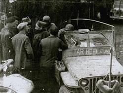 Survivors around a jeep