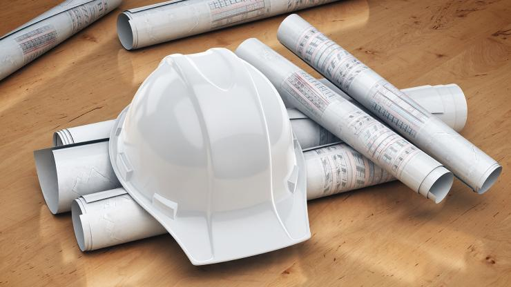 Design Plans and Hard hat on table