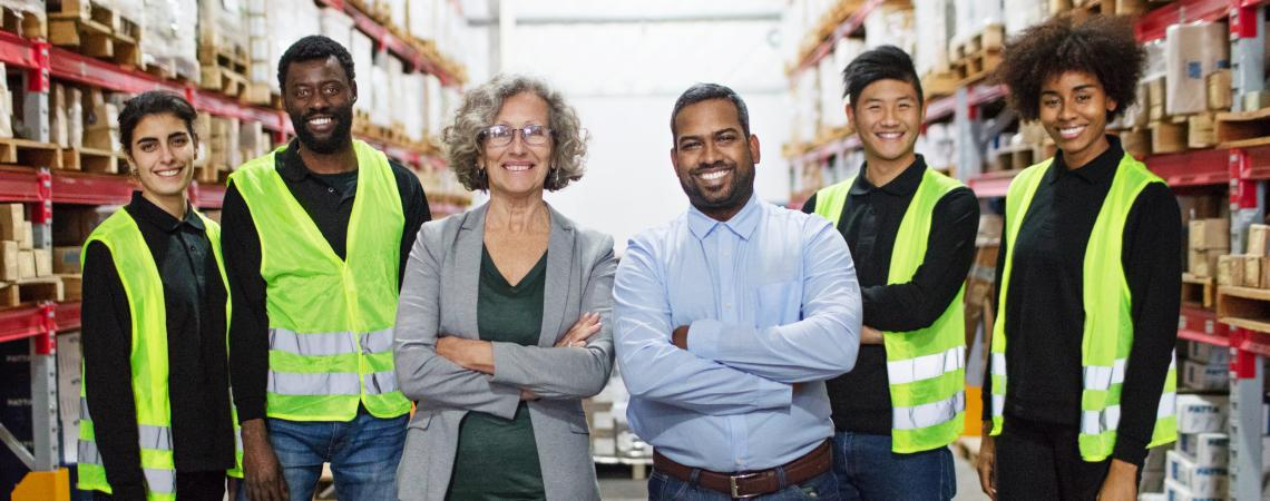 Group of employees standing with arms crossed
