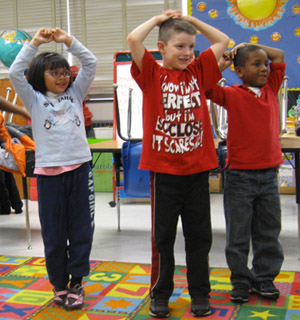 Booker T. Washington students act out a story