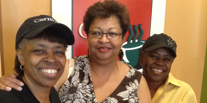 Bridgette Lacy (center) poses with Gail Phelps (left) and Kaye Roberts at GK Cafe.