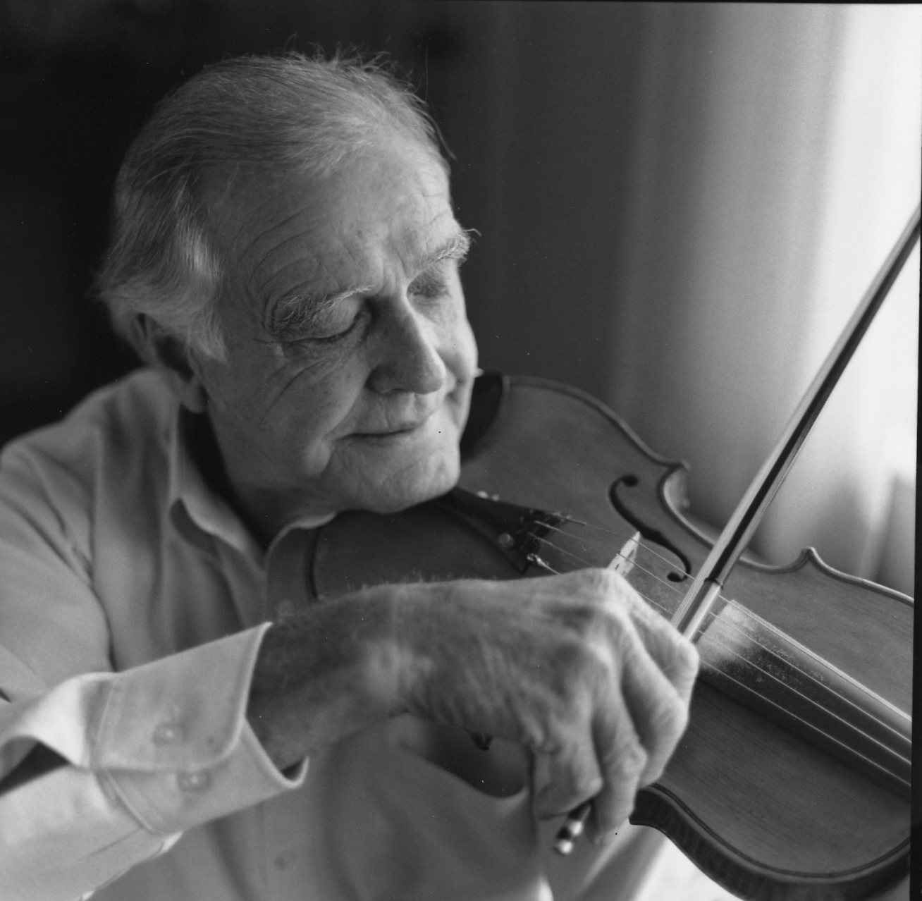 Jim Shumate with his fiddle | Photo Credit: Cedric N. Chatterley