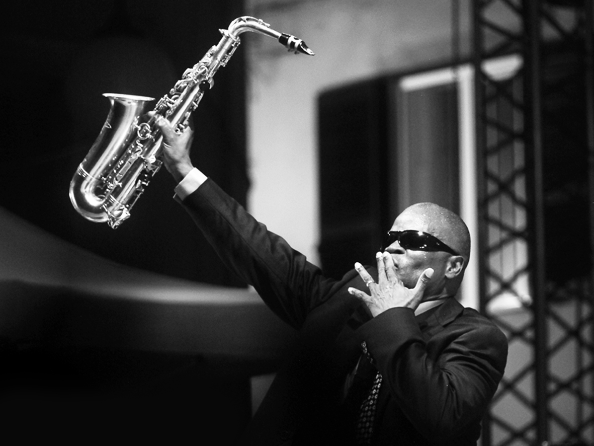 Maceo Parker holding his saxophone
