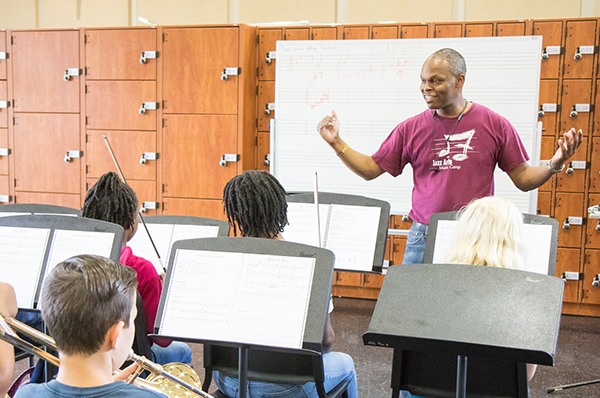 Pictured here - A conductor with his students at the Jazz Arts Initiative in Charlotte
