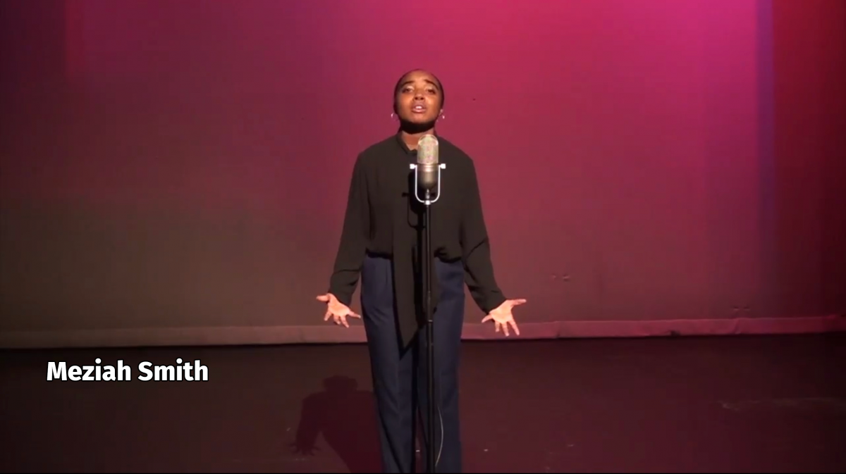 Meziah Smith on stage reciting a poem