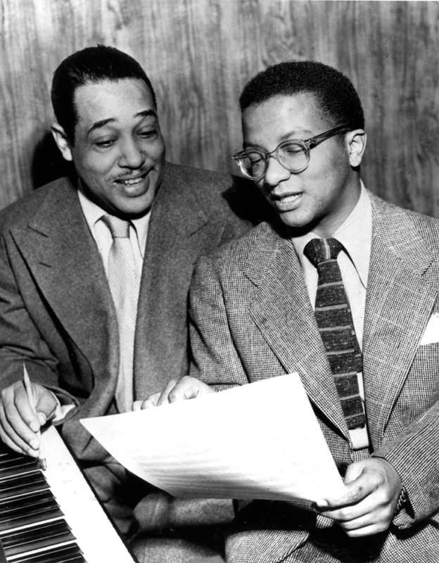 Billy Strayhorn reviewing some sheet-music with Duke Ellington | Photo Credit: Frank Driggs Collection