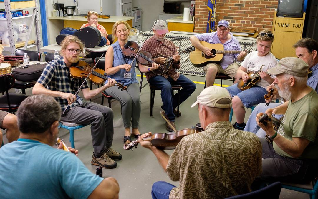 A group of musicians circled up at the Mount Airy Old-Time Retreat