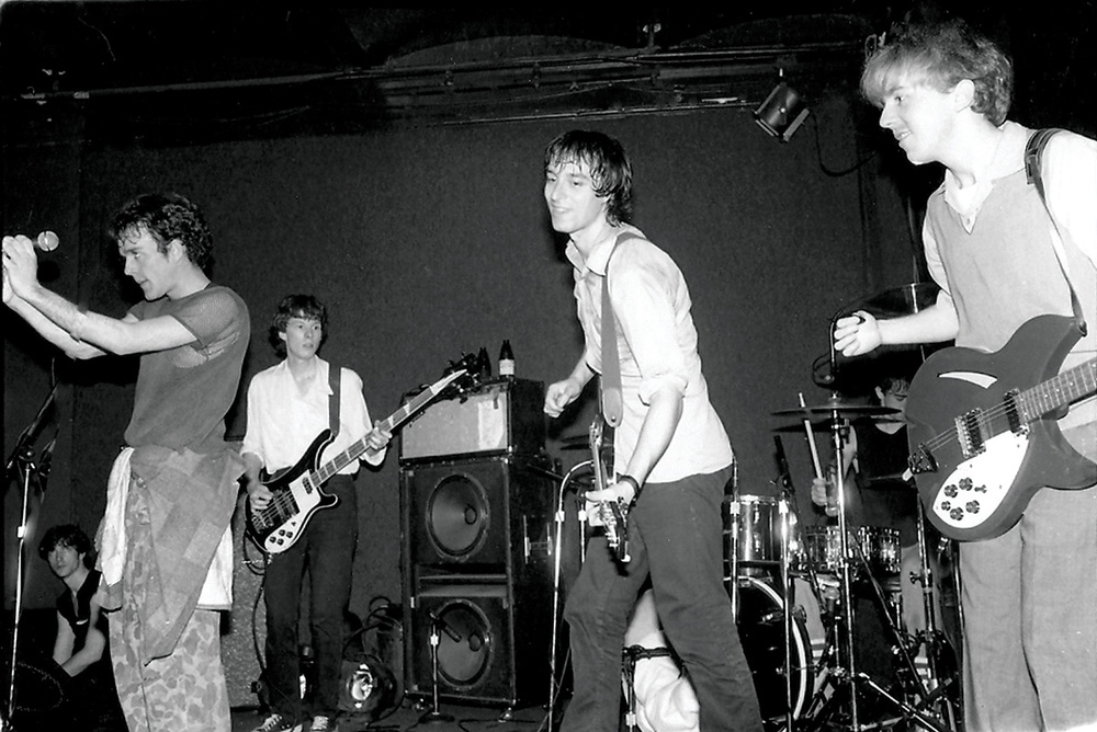 Mitch Easter (center) performing with R.E.M. in 1982