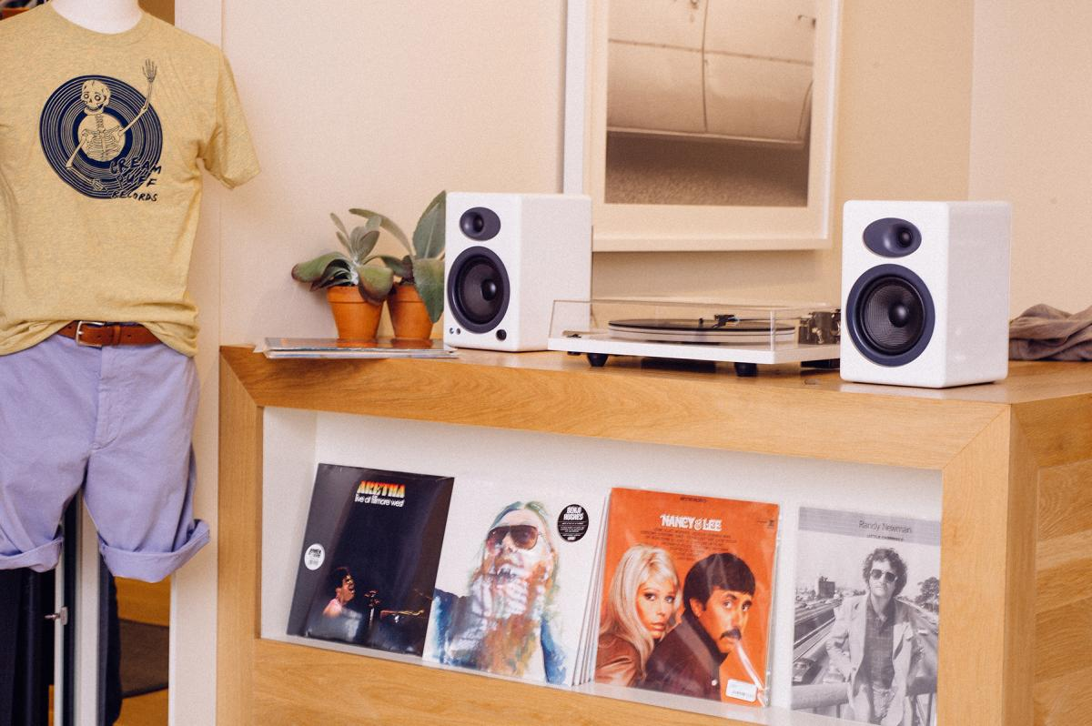 A record player with some merchandise and records on display at Cream Puff Records