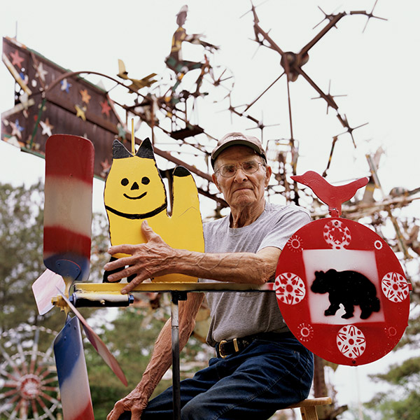 Portrait of Volis Simpson with his whirligigs