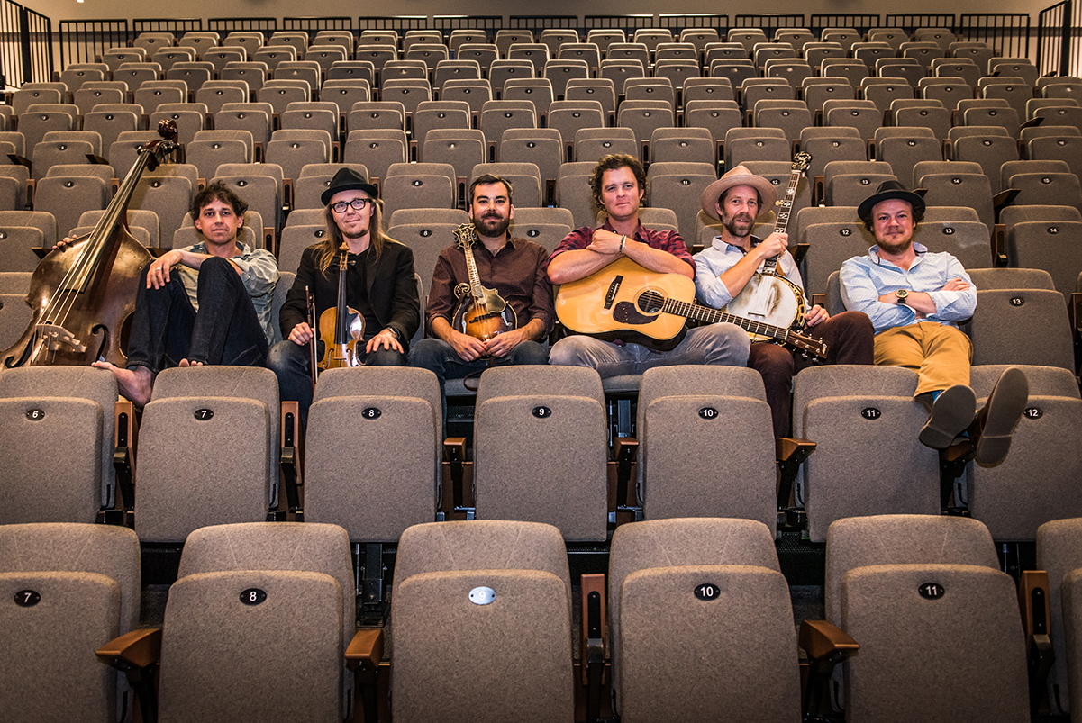 Photo of the Steep Canyon Rangers sitting in an auditorium with their instruments