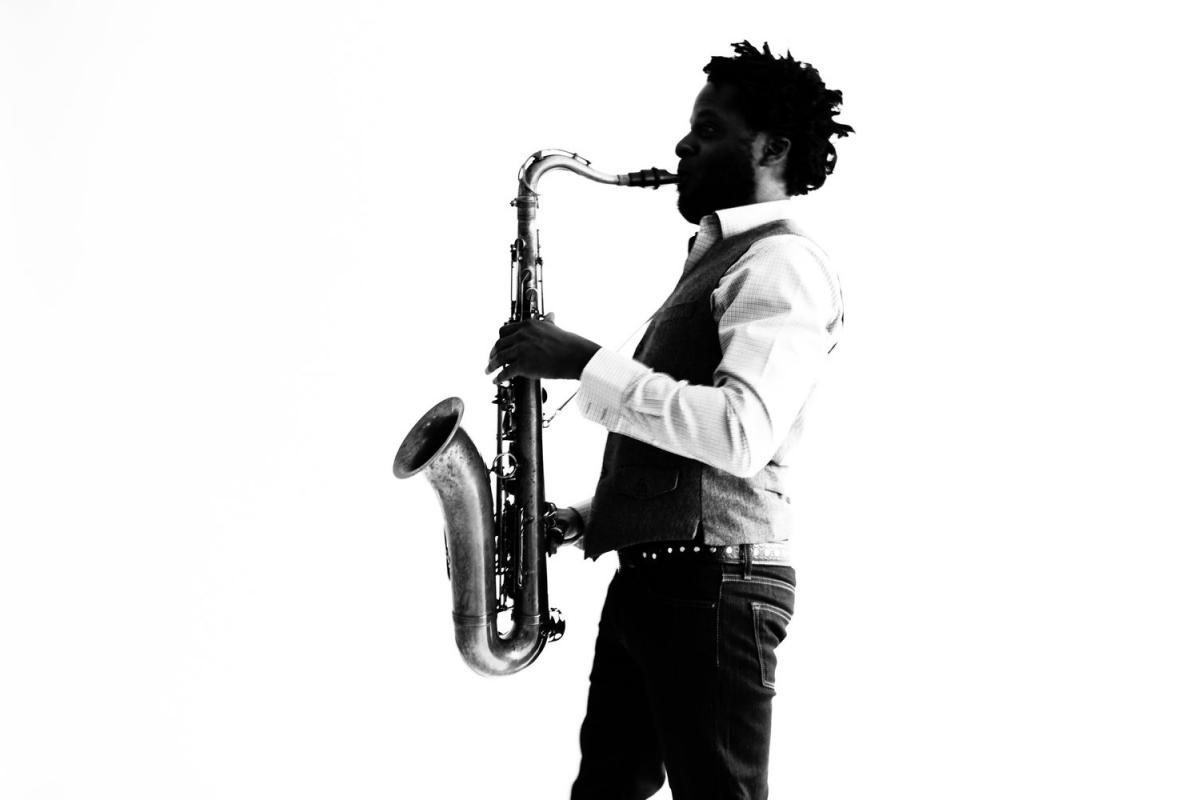Brian Horton posing with his saxophone