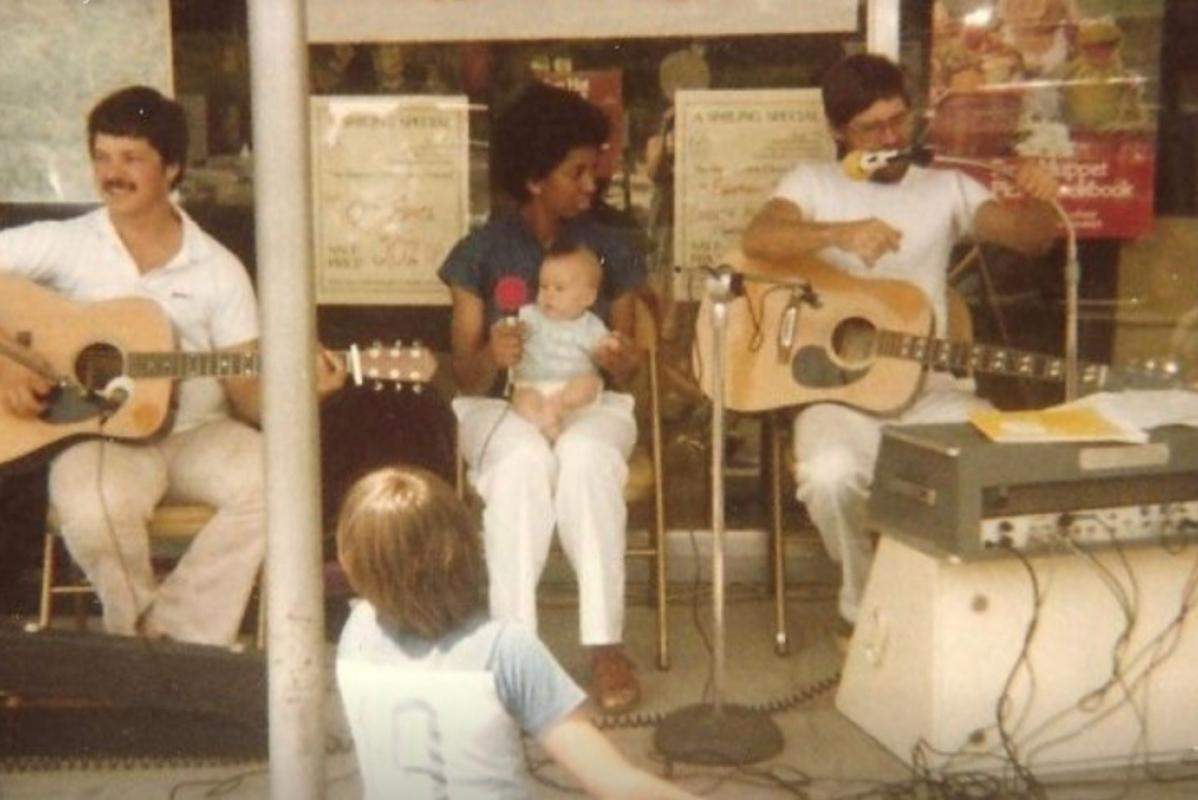 Carey Rowland (right) performing in front of King Street Pharmacy, 1981.