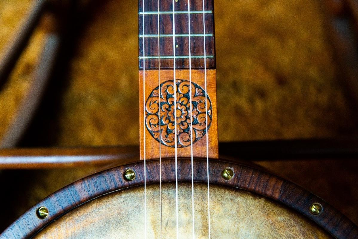A beautiful carved inlay designed by luthier Ryan Navey.