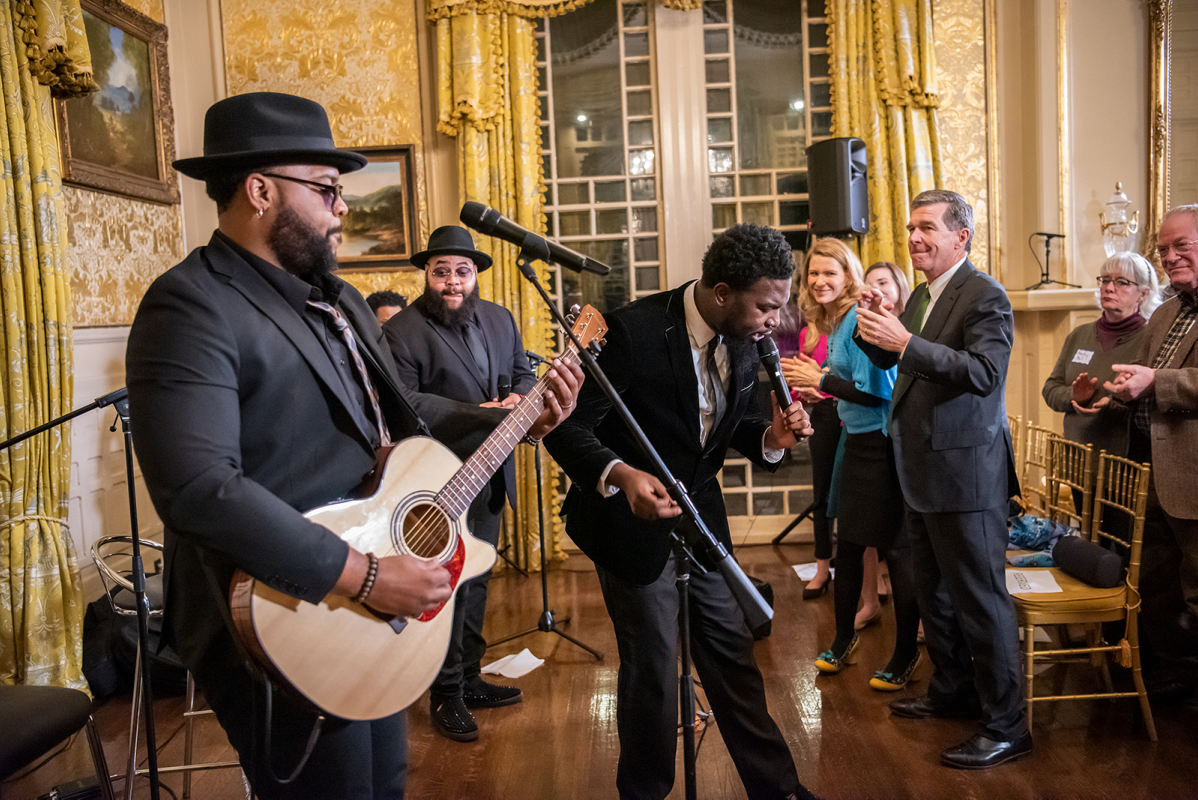 The Hamiltones performing at the Governor's Mansion in front of a crowd that includes Governor Roy Cooper and First Lady Kristin Cooper