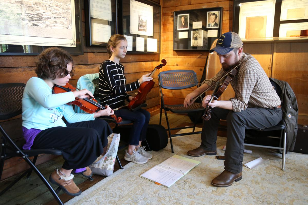 Students learning fiddle at the Boone, NC TAPS/JAM Program | Photo by N.C. Arts Council Folklife Specialist Zoe van Buren
