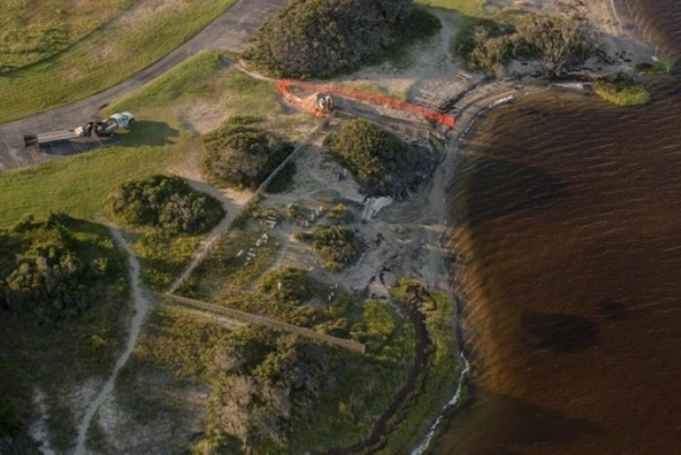 A 2017 aerial photo of the Salvo Community Cemetery shows decades of erosion
