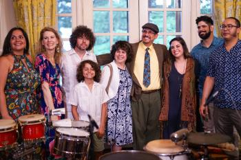 Chócala with their family members and Kristin Cooper