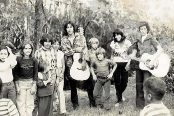 Willie French Lowery (center with guitar) surrounded by Lumbee family and community members | Photo credit: WillieFrenchLowery.wordpress.com