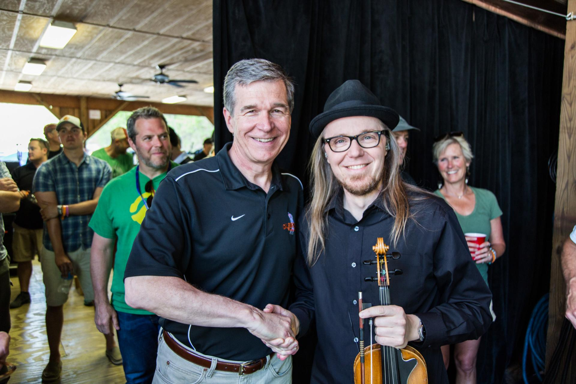 Governor Roy Cooper and Nicky Sanders of the Steep Canyon Rangers