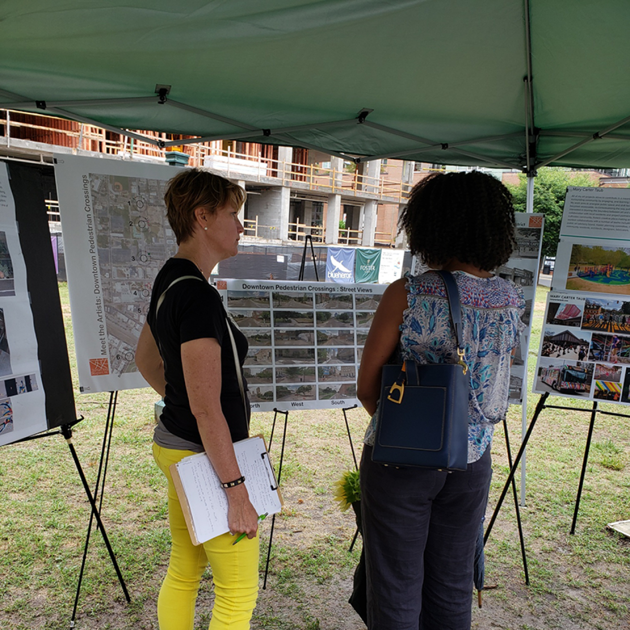 Mary Carter Taub speaking to a community member