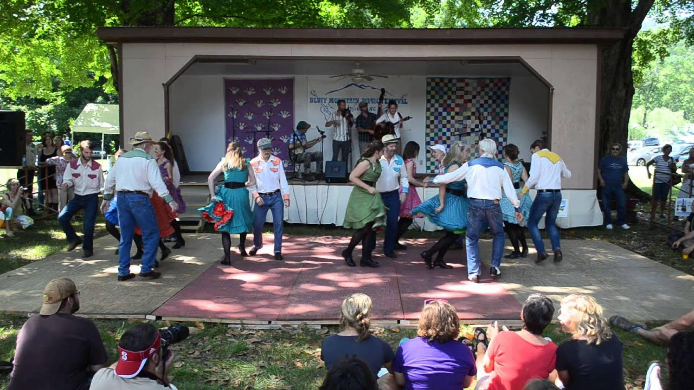 Musicians and dancers performing at the Bluff Mountain Festival