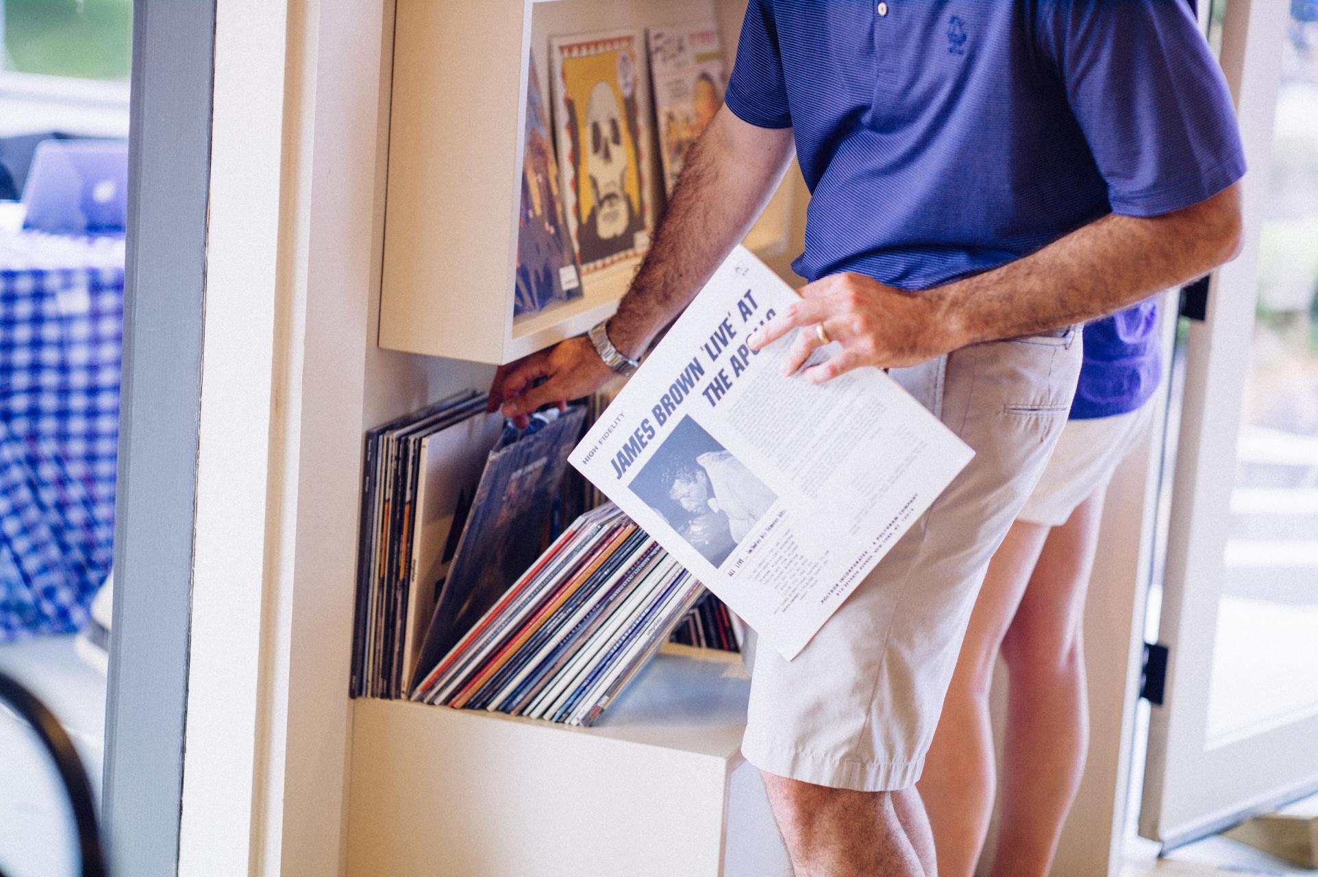 A customer perusing the record bins at Cream Puff Records