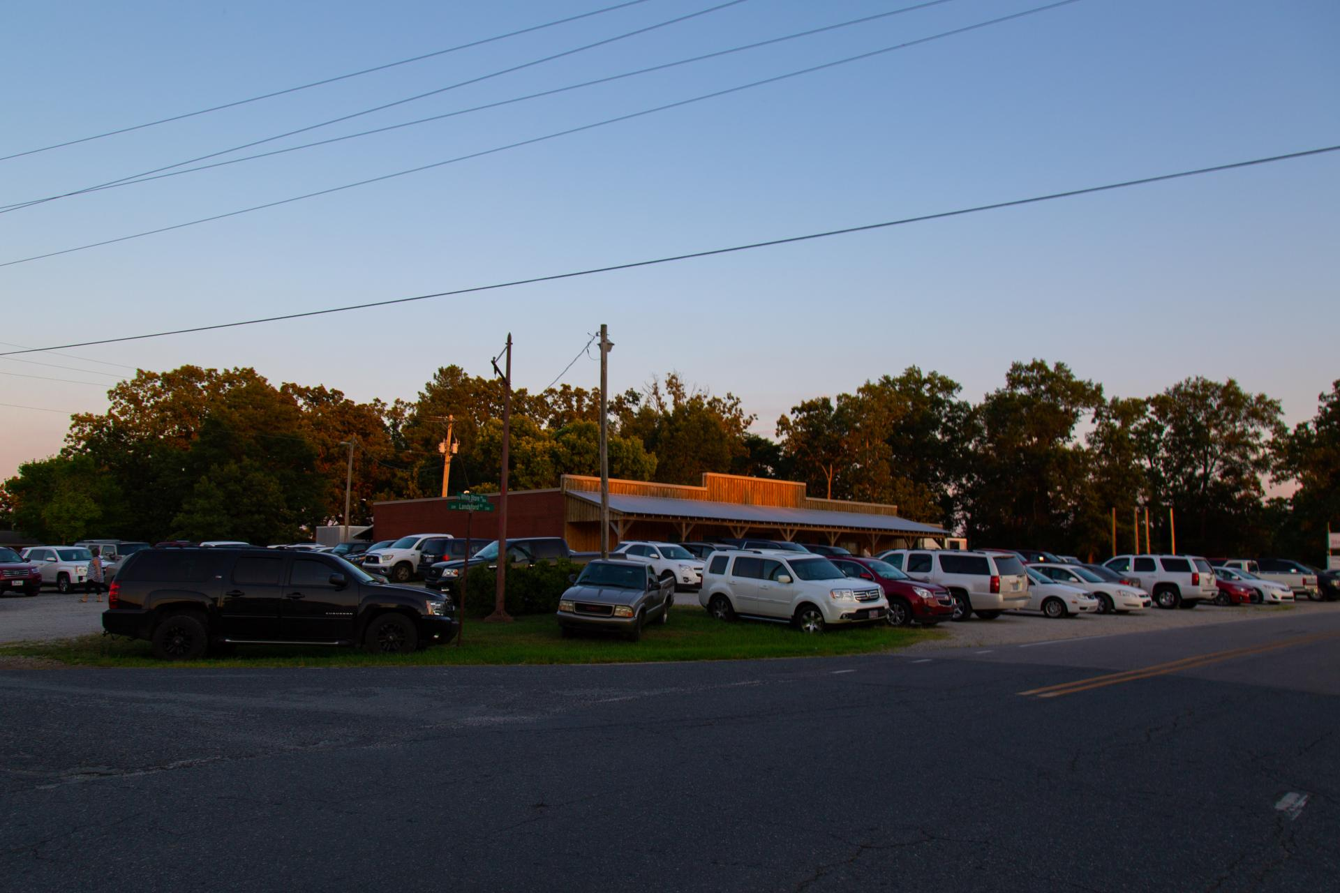 A full parking lot outside the Old Hargett Store