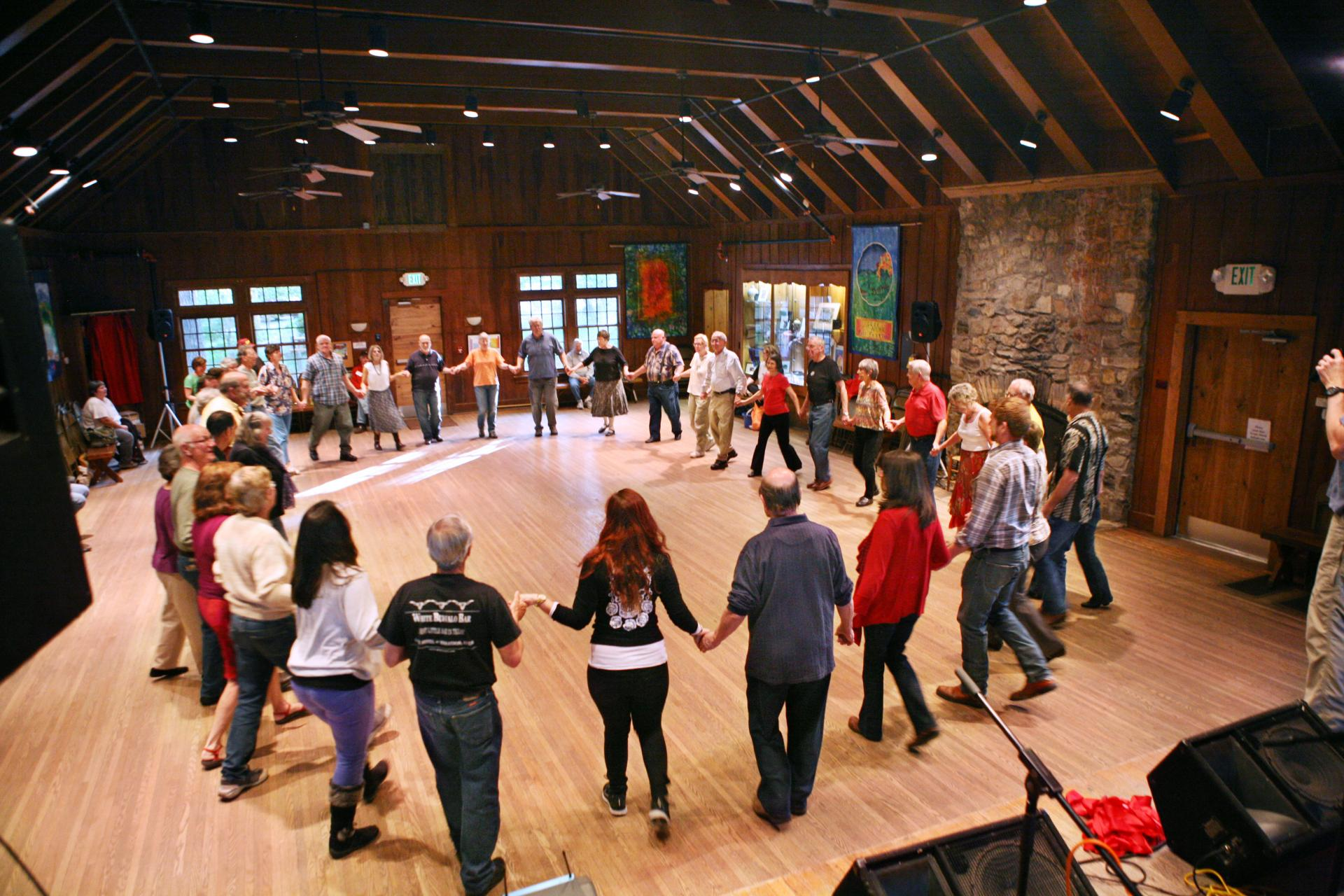 "A circle of dancers at Tuesday night ""Learn How to Contra"" dance class"