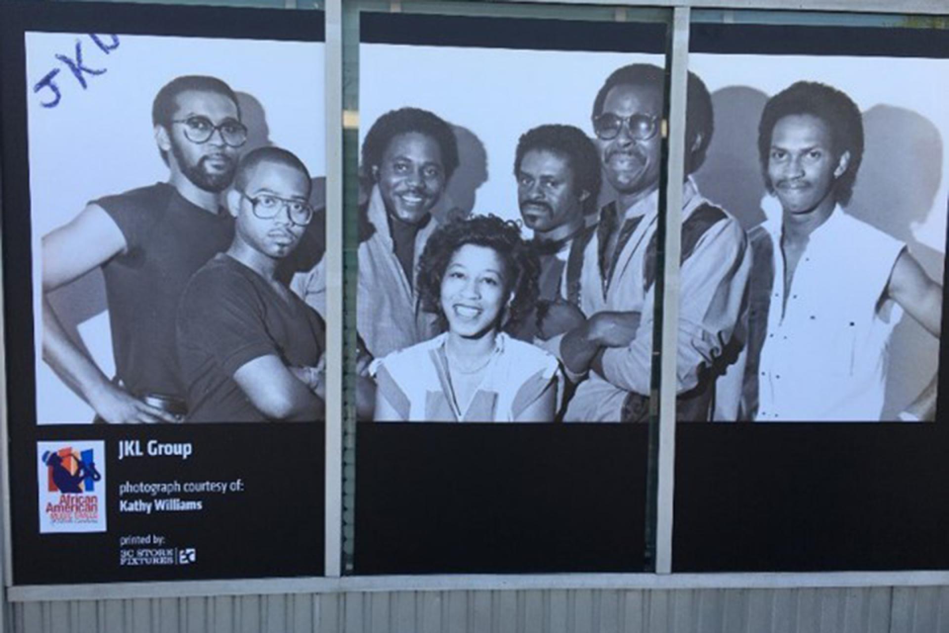 Kinston storefront exhibit. Photo of JKL Group courtesy of Kathy Williams.