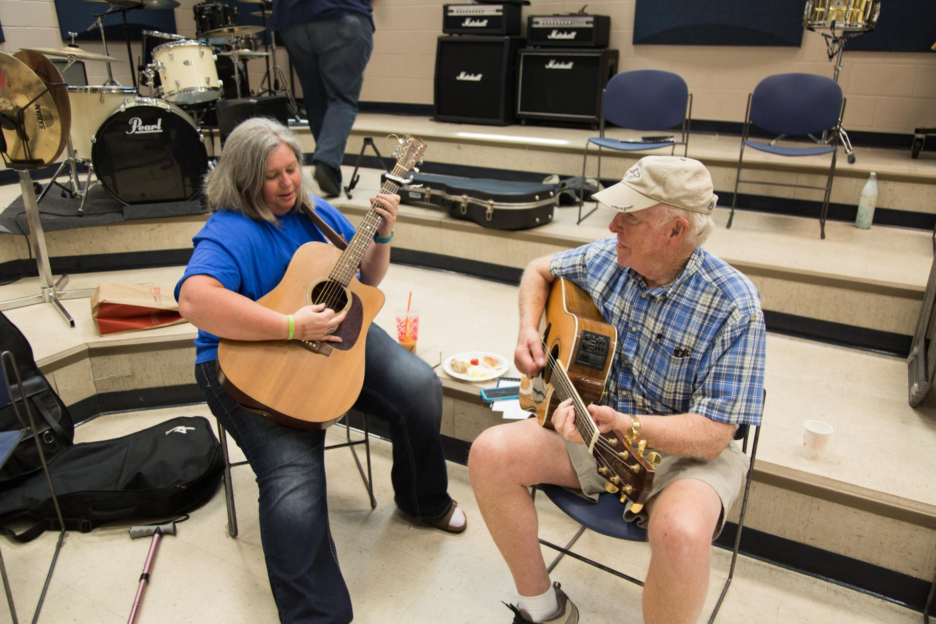 Two students practice at the N.C. Veterans Songwriting Workshop