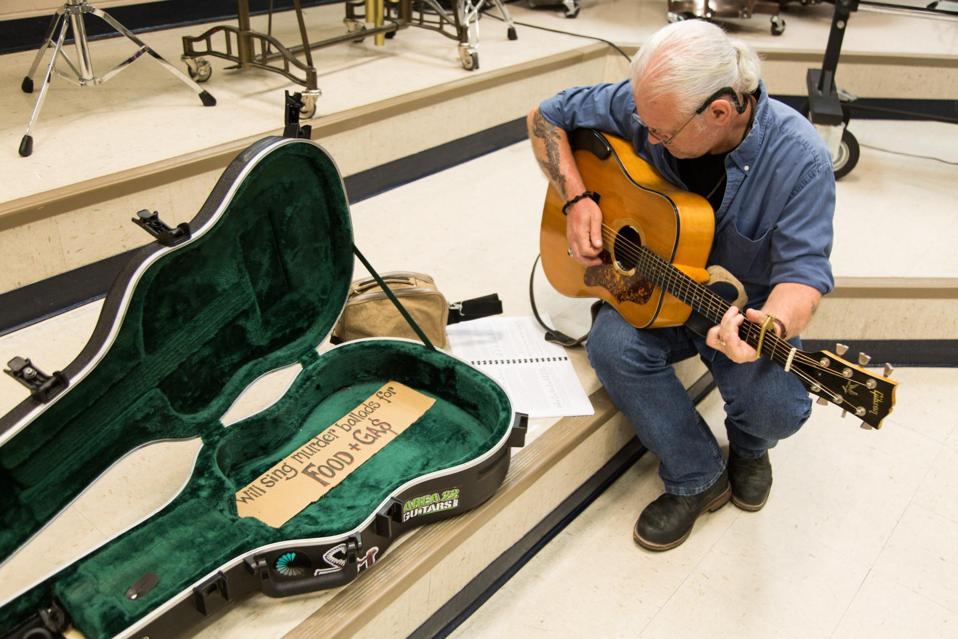 David Wiseman practices a song at the 2019 N.C. Veterans Songwriting Workshop