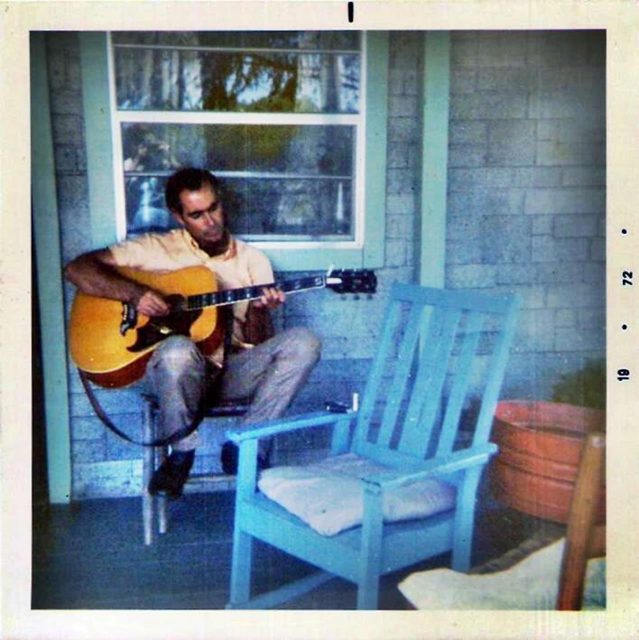 "Jerry Marshall ""Pap"" Wilson playing his guitar on the porch, 1972"