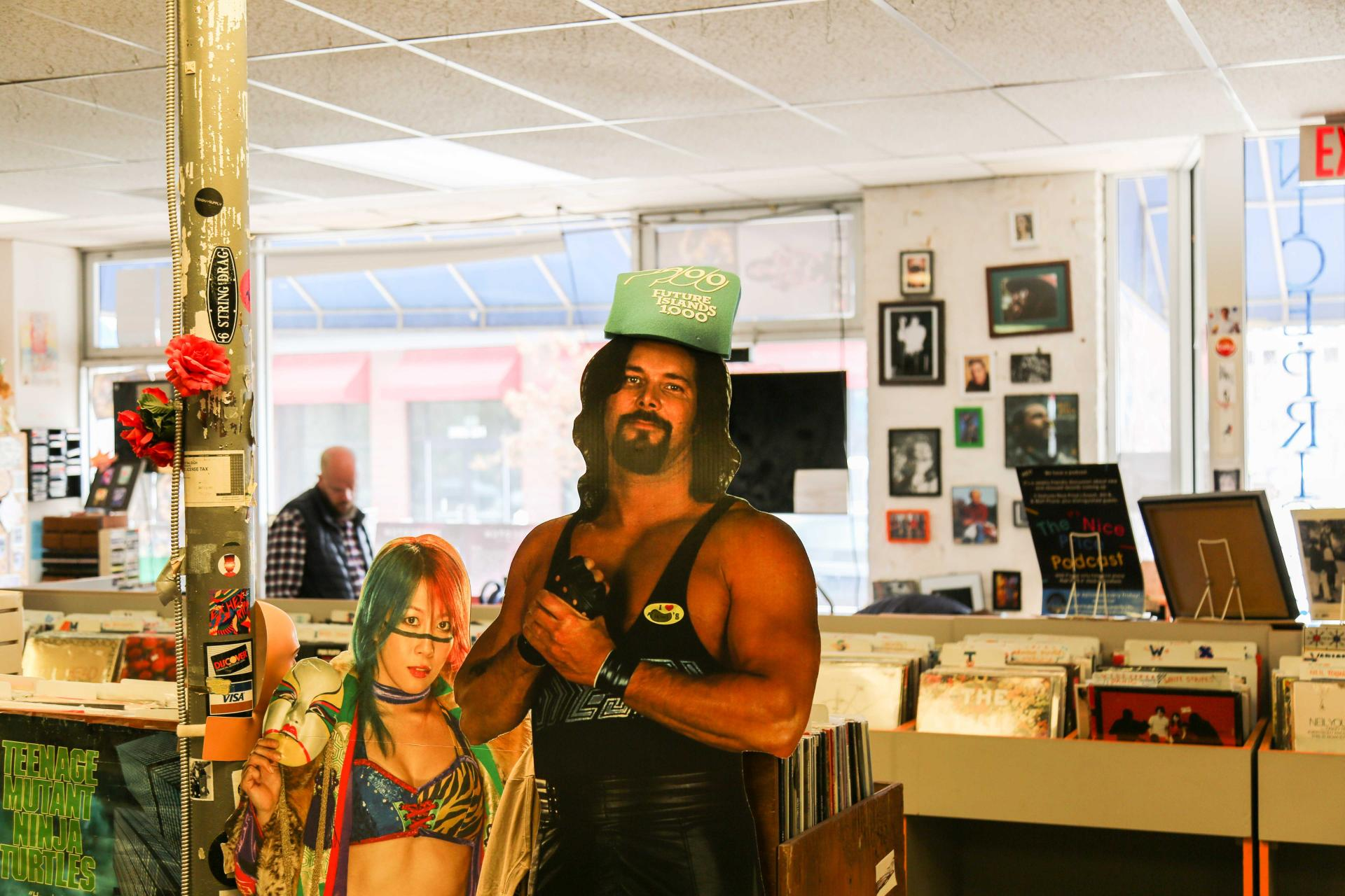 Pictured here: Two pro-wrestler cardboard cut-outs sporting some NC Music gear
