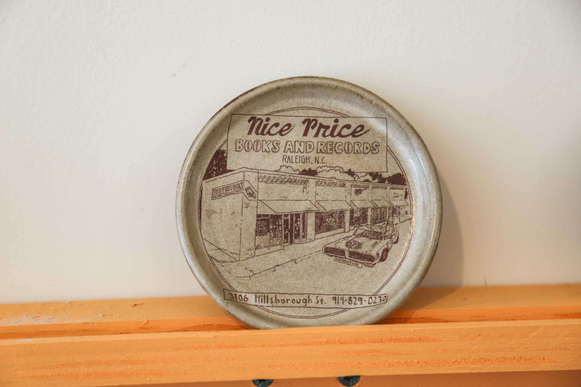 Pictured here: a clay coaster depicting a stylized version of Nice Price Books & Records' storefront