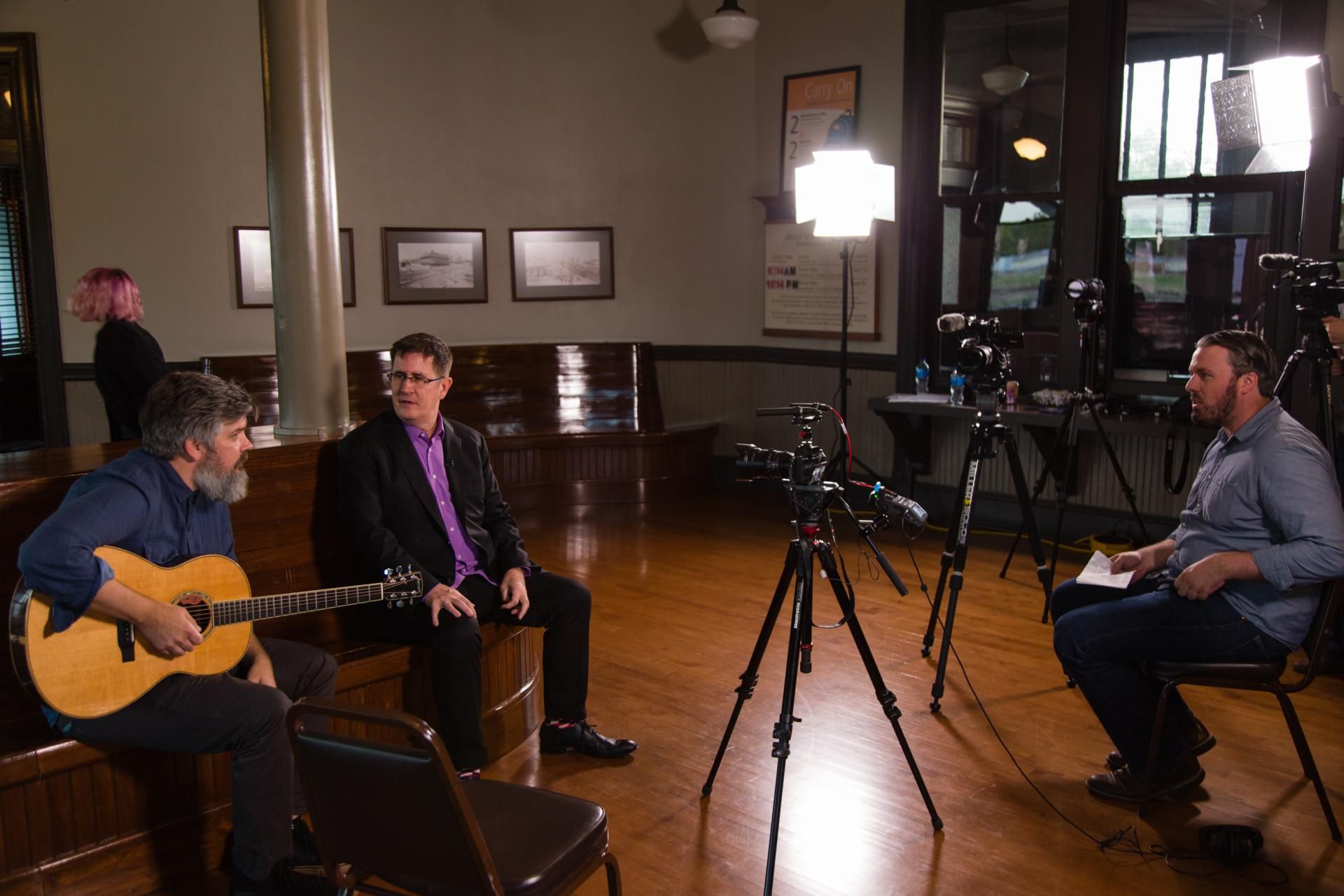 Come Hear NC team member Samuel Gerweck prepares to interview the Mountain Goats