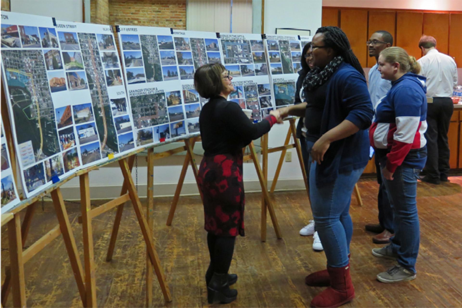 Artist Vicki Scuri meeting a community member
