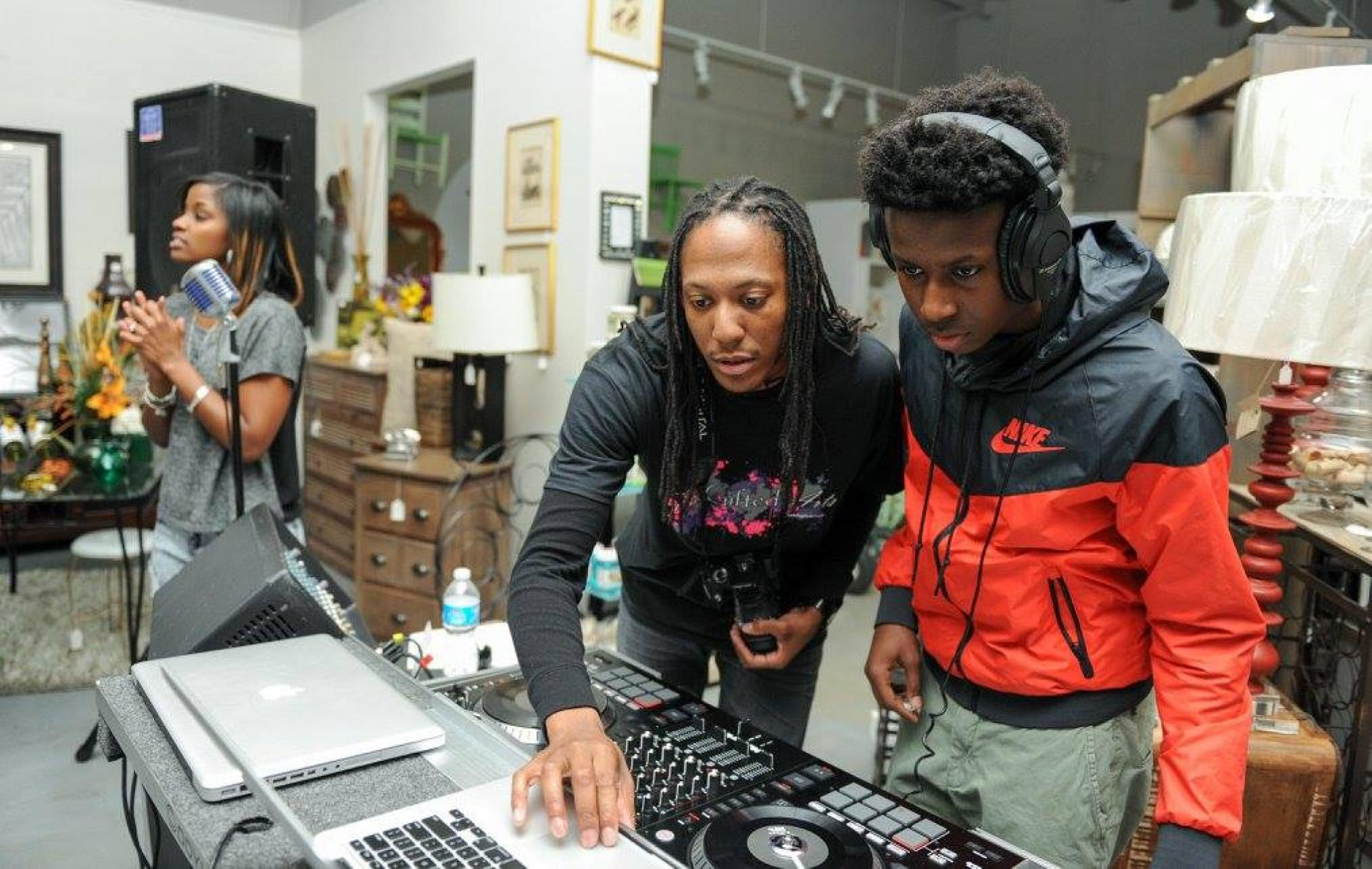 Clarence 'CJ' Morgan DJing with a TheGifted Arts student at a 2016 event