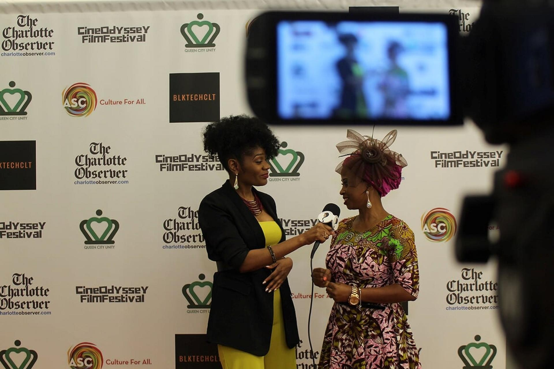 Red Carpet Host Saran Almond interviews filmmaker Gladys Edeh at the CineOdyssey Film Festival | Photo Credit: Zach Smith