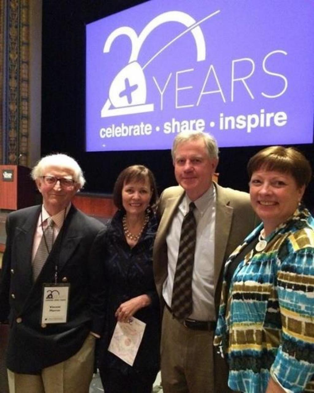 Vincent Marron, Jean Hendrickson, Wayne Martin, and Michelle Burrows celebrate the 20th anniversary of A+ Schools.